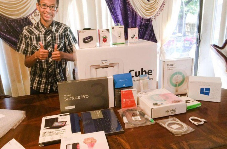 Ahmed receives surface pro 3 from Microsoft